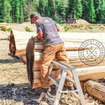 One of our awesome workers chiseling a Hand Crafted Western Red Cedar Log at our yard in British Columbia.