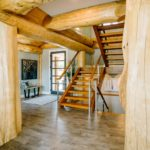 Handcrafted Timber Frame Stairs in Log Post and Beam Home