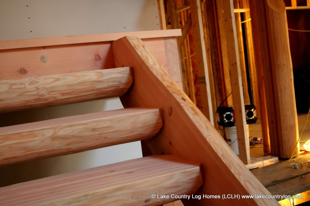 handcrafted log and timber stairs and railings