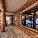 Covered Porch on a Handcrafted Western Red Cedar Log Cabin House in Colorado