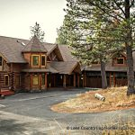 Beautiful Douglas Fir hand crafted log home by Lake Country Log Homes with beautiful railings and double garage.