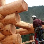 Staggered hand crafted Western Red Cedar log ends on a shell being constructed by Lake Country Log Homes in British Columbia.