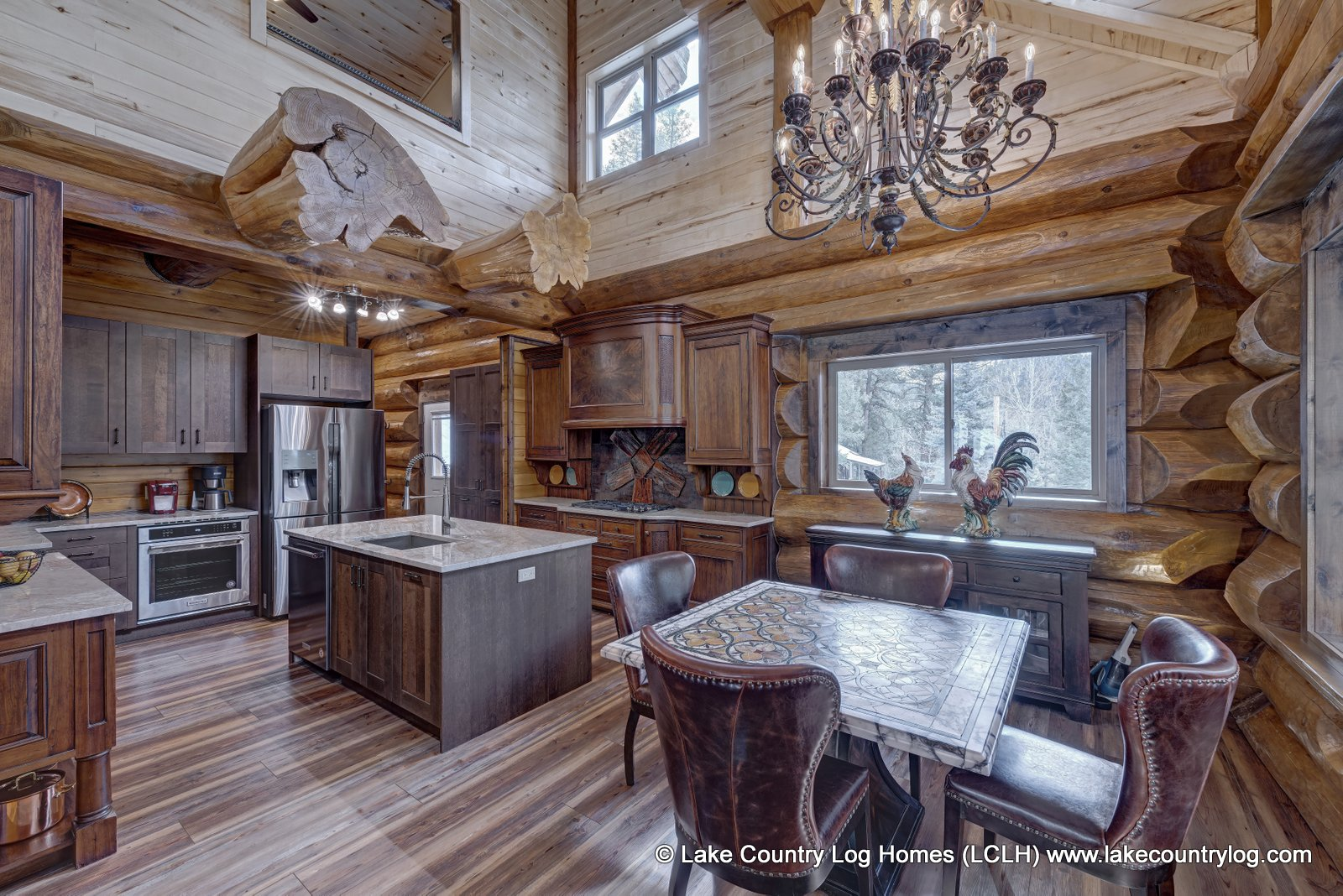 Rustic Luxury: Western Red Cedar Log Cabin Home Kitchen / Dining Room built in Colorado